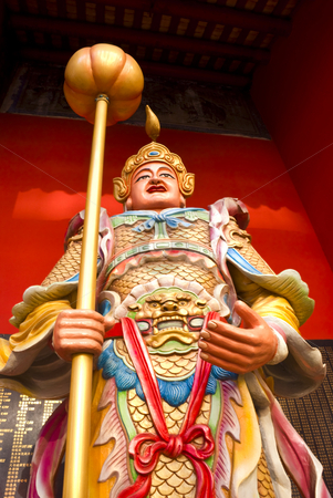 Chinese Guard stock photo, The statue of a Guard at a Buddhist Temple in China by Stefan Breton