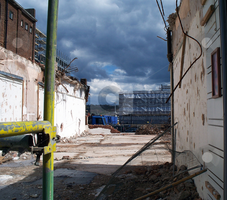 Demolition In Progress stock photo, A photograph documenting the demolition of a building, under a brooding sky by Philippa Willitts