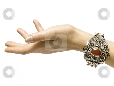 Hand with bracelet stock photo, Silver bracelet on white background isolated by Adrian Costea