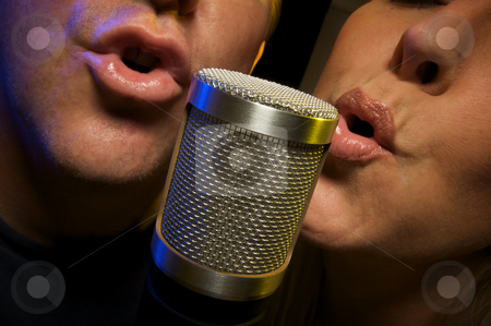Couple Singing Duet stock photo, Couple Singing Duet at Condenser Microphone. by Andy Dean