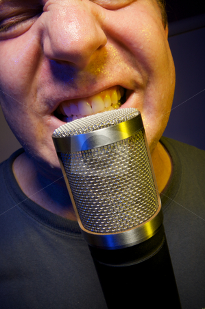 Vocalist and Microphone stock photo, Passionate Vocalist & Microphone by Andy Dean