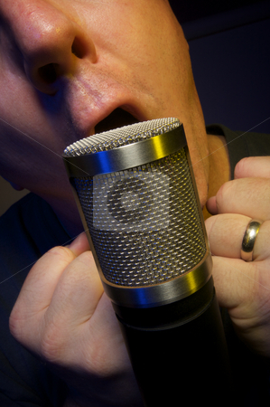 Vocalist howling Microphone stock photo, Passionate Vocalist & Microphone by Andy Dean