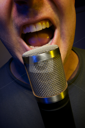 Vocalist yelling into Microphone stock photo, Passionate Vocalist & Microphone by Andy Dean