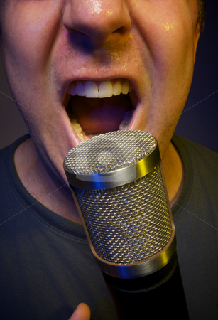 Vocalist singing into Microphone stock photo, Passionate Vocalist & Microphone by Andy Dean