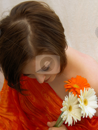 Soft stock photo, A beautiful brunette, wearing red, with a bouquet of daisies, looking down demurely. by Jessica Tooley