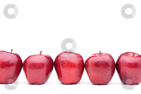 Red delicious apples with on eaten apple  stock photo, Red apples line up on a white background by Vince Clements
