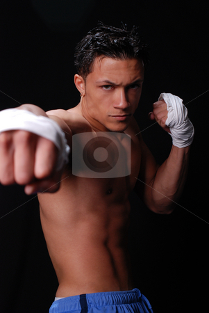 Sparring stock photo, Young athlete sparring while working out. by Michael Huitt
