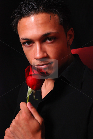 Romantic stock photo, A romantic young man with a rose for his significant other. by Michael Huitt