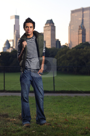 Central Park Fashion stock photo, A young male model shows off the latest casual fashions in an early morning New York City Central Park location. by Michael Huitt