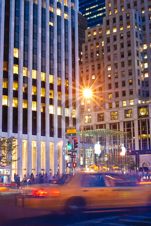 New York Rush stock photo, Dusk at the busy intersection of 59th Street by Michael Huitt