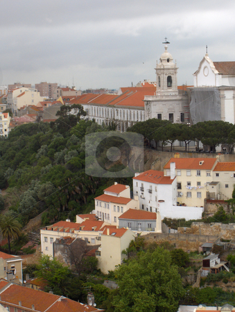 Rooftops stock photo, White and pastel homes with terra cotta tile rooves in Lisbon, Portugal by Jessica Tooley