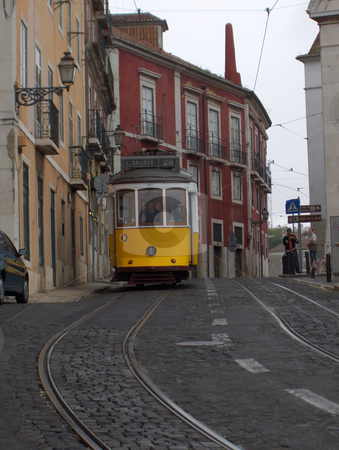 Yellow Streetcar stock photo, An historic yellow tram in Lisbon, Portugal. by Jessica Tooley