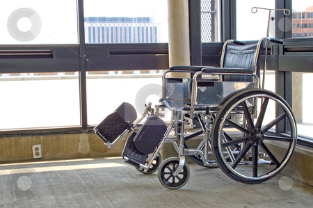 Wheelchair stock photo, A lone wheel chair void of a passenger. by Robert Byron