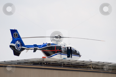 Life Flight stock photo, A life flight helicopter getting ready for takeoff. by Robert Byron