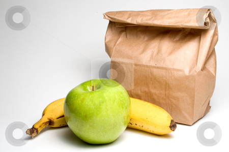 Bag Lunch with Fruit stock photo, Bag lunch with a banana and an apple. by Robert Byron