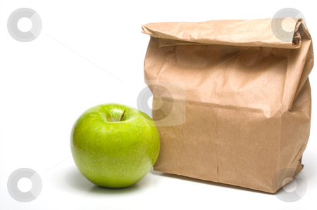Bag Lunch and an Apple stock photo, A bag lunch with a Granny Smith apple. by Robert Byron