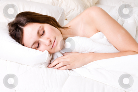 Sleeping bright woman stock photo, Young awe woman in sleeping in a bed by Frenk and Danielle Kaufmann