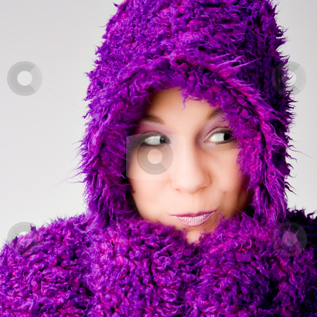 Model wearing purple hooded sweatshirt stock photo, Beautiful young good looking woman with a hooded sweater by Frenk and Danielle Kaufmann