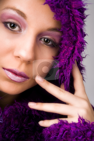 Woman wearing fluffy purple coat stock photo, Young woman with a hypnotizing look by Frenk and Danielle Kaufmann
