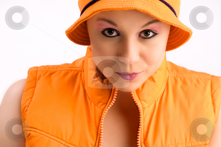 My orange body warmer stock photo, Beautiful young good looking woman with a body warmer by Frenk and Danielle Kaufmann