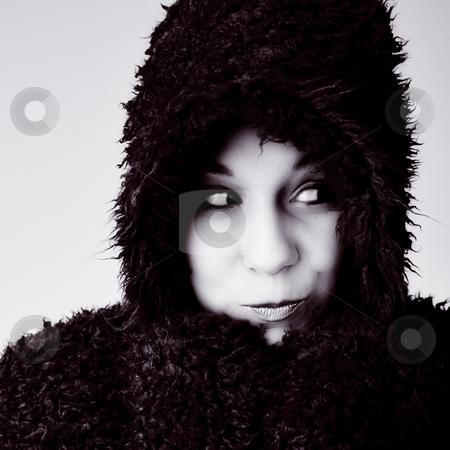 Woman bundled up in fur coat stock photo, Beautiful young good looking woman with a hooded sweater by Frenk and Danielle Kaufmann