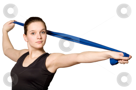 Stretching with a Resistance Band stock photo, Young girl is sporting in the studio on a white background by Frenk and Danielle Kaufmann