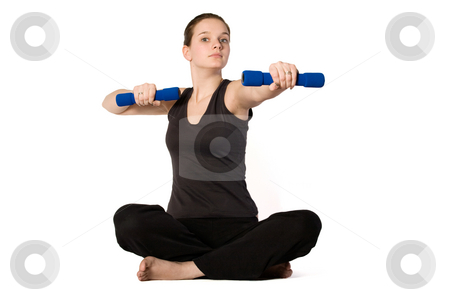 Young girl is sporting with weights stock photo, Young girl is sporting in the studio on a white background by Frenk and Danielle Kaufmann