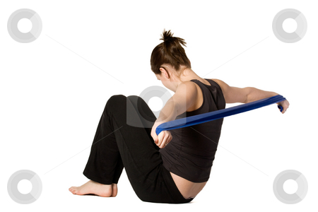 Woman is stretching her arms stock photo, Young girl is sporting in the studio on a white background by Frenk and Danielle Kaufmann