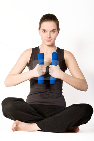 Woman with weights stock photo, Young girl is sporting in the studio on a white background by Frenk and Danielle Kaufmann