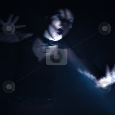 Alternative woman attacked by light source of a unknown kind stock photo, Scary horror scene with light painted equipment by Frenk and Danielle Kaufmann