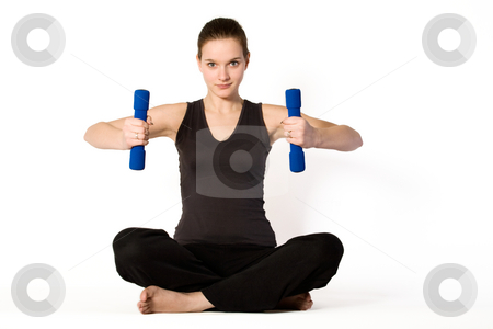 Young girl is concentrating on weights stock photo, Young girl is sporting in the studio on a white background by Frenk and Danielle Kaufmann