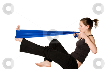 Woman is stretching her leg with a Resistance Band stock photo, Young girl is sporting in the studio on a white background by Frenk and Danielle Kaufmann
