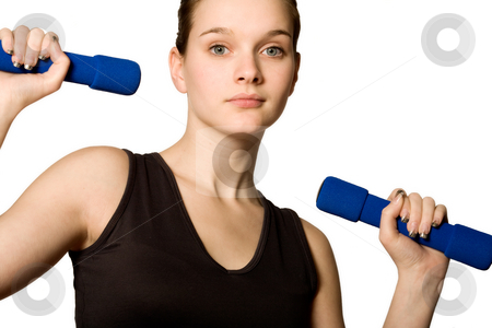 Young girl is holding the weights stock photo, Young girl is sporting in the studio on a white background by Frenk and Danielle Kaufmann