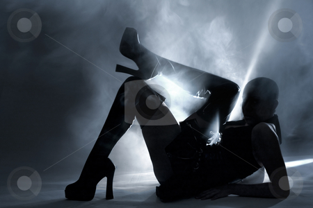 Silhouette created by light painting stock photo, Light painted silhouette of a young alternative woman by Frenk and Danielle Kaufmann