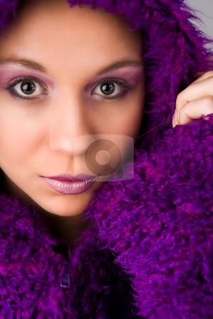 Woman wearing purple fur coat stock photo, Young woman with a hypnotizing look by Frenk and Danielle Kaufmann