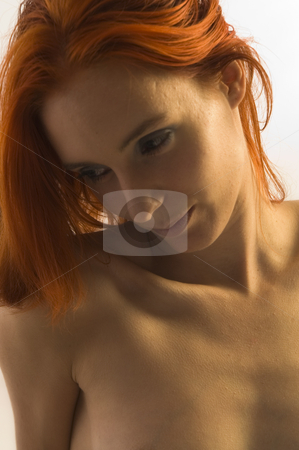 Wicked Girl with red hair stock photo, Portrait of a naked model with bright red hair by Frenk and Danielle Kaufmann