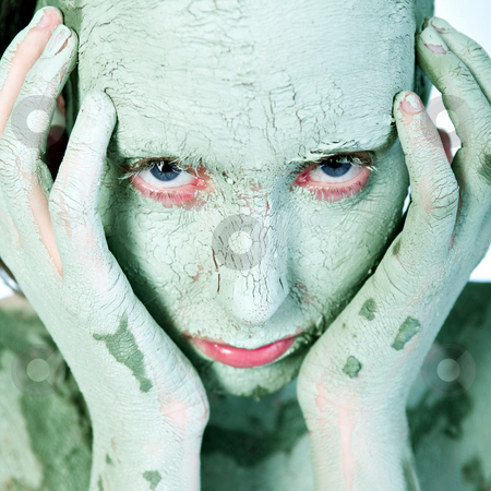 Face covered in green clay stock photo, Nude woman model wearing a clay mask by Frenk and Danielle Kaufmann
