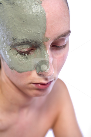 Relaxing with a partial clay mask stock photo, Nude woman model with a partial clay mask by Frenk and Danielle Kaufmann