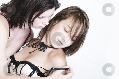 Gently undressing my lesbian girlfriend stock photo, Two young female lovers undressing gently by Frenk and Danielle Kaufmann