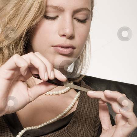 Check my nails stock photo, Portrait of a beautiful blond model checking her nails by Frenk and Danielle Kaufmann