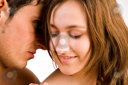 Loving faces stock photo, Young adult couple in the studio hugging by Frenk and Danielle Kaufmann