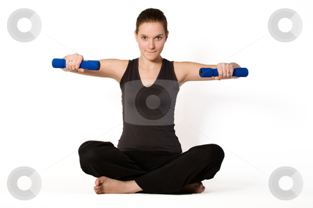 Young girl is holding balance with weights stock photo, Young girl is sporting in the studio on a white background by Frenk and Danielle Kaufmann