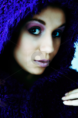 Woman in purple fur coat stock photo, Young woman with a hypnotizing look by Frenk and Danielle Kaufmann