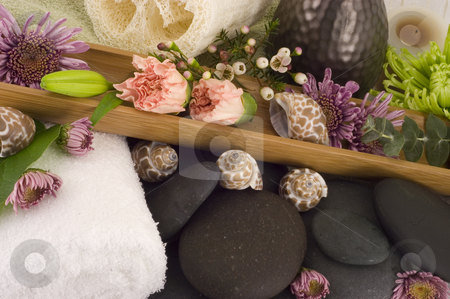 Massage Stones stock photo, Massage Stones, Flowers, and Towel 5 by Ariana Bauer