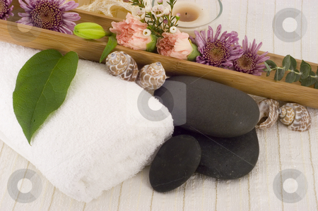 Massage stones stock photo, Massage Stones, Flowers, and Towel 2 by Ariana Bauer