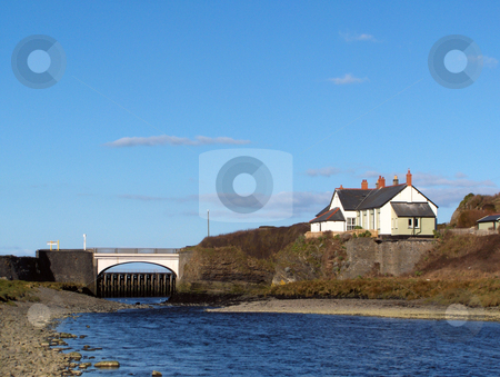 Lonely House stock photo, An isolated white house and a bridge on a river near Aberystwyth, Wales. by Jessica Tooley