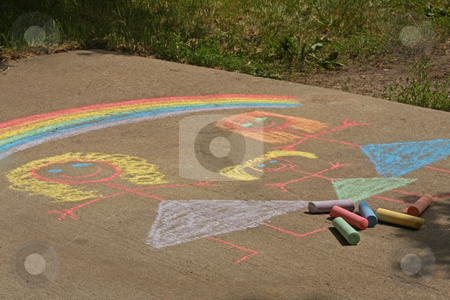 Lesbian Family drawn in chalj stock photo, Concept image for gay parenting or gay marriage; a chalk child's drawing on a sidewalk or driveway, of two women and a female child with a rainbow over their heads. by Jessica Tooley