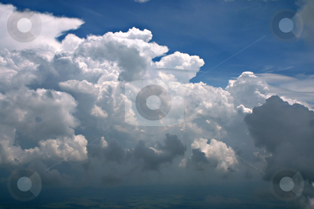 Rolling Thunder clouds stock photo, Approaching storm clouds from above by Marc Saegesser