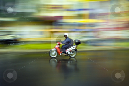 Motor Bike Blur stock photo, A motion blurred man on a motor bike by Stefan Breton