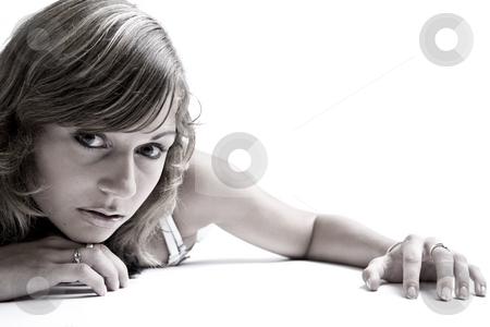 Teenager crawling towards you stock photo, Studio portrait of a teenage model on the floor by Frenk and Danielle Kaufmann